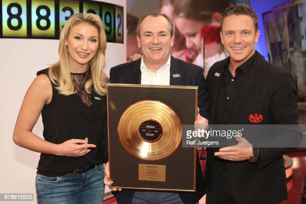 AnnaCarina Woitschack Wolfram Kons and Stefan Mross attend the 22nd RTL Telethon on November 24 2017 in Huerth Germany