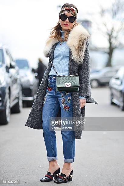 Annacarla Dall'Avo poses wearing a Scervino coat Topshop turtrleneck and pants Chanel bag and Gucci shoes after the Celine show at the Tennis Club de...