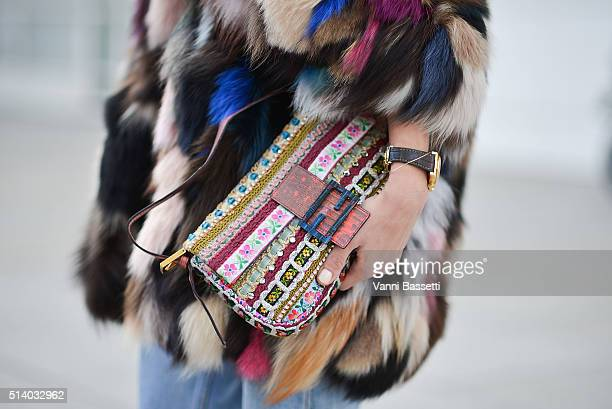Annacarla Dall'Avo poses wearing an Essentiel fur and Fendi bag before the Balenciaga show during Paris Fashion Week FW 16/17 on March 6 2016 in...