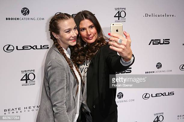 AnnaKatharina Samsel and Claudelle Deckert attend the PF Selected show during Platform Fashion January 2017 at Areal Boehler on January 28 2017 in...