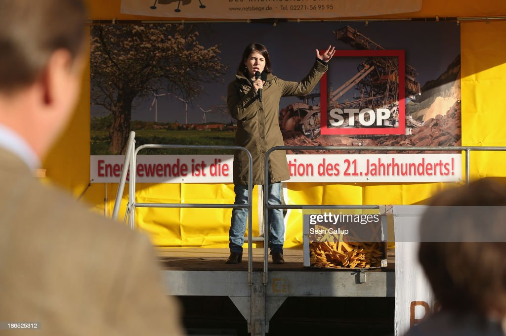 Annalena Baerbock, head of Brandenburg German Greens Party (Buendnis 90/Die Gruenen) speaks at a protest against the expansion of open-pit lignite coal mines at the annual village fest on October 31, 2013 in Atterwasch, Germany. According to plans by Swedish energy conglomerate Vattenfall and approved by the Brandenburg state legislature, Atterwasch and at least four other communities are to be raized and their inhabitants compensated and relocated in order to make way for the expansion of the mines. Energy policy and the role of coal is a heated topic at the moment in coalition negotiations between the Social Democrats (SPD) and Christian Democrats (CDU) currently taking place in Berlin.