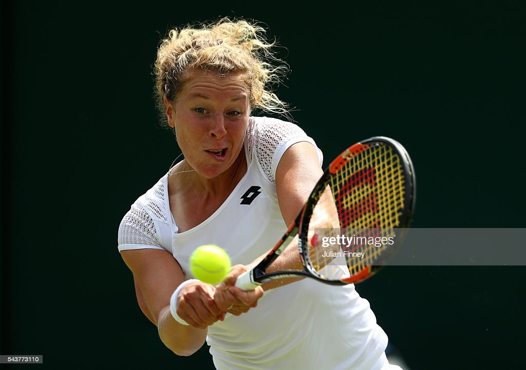 Anna-Lena Friedsman of Germany plays a backhand during the Ladies Singles second round match against Ekaterina Alexandrova of Russia on day four of the Wimbledon Lawn Tennis Championships at the All England Lawn Tennis and Croquet Club on June 30, 2016 in London, England.