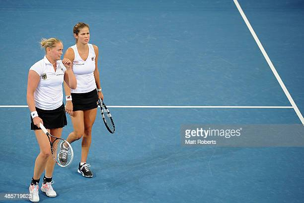 AnnaLena Groenefeld and Julia Goerges of Germany talk tactics in their doubles match against Ashleigh Barty and Casey Dellacqua of Australia during...