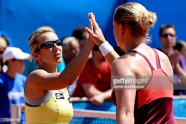 AnnaLena Groenefeld of Germany and Kveta Peschke of Czech Republic high five in their Doubles quarterfinal match against Kristina Barrois and...