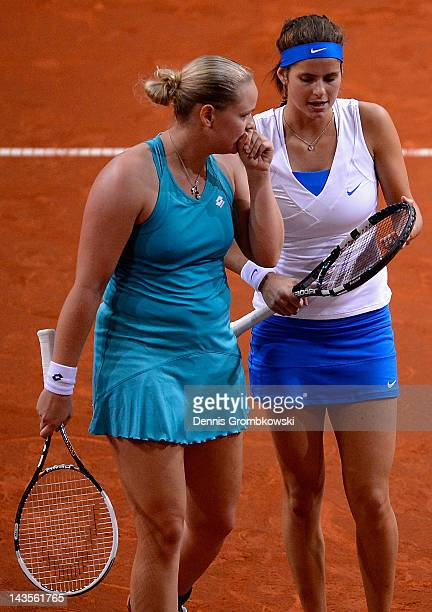 AnnaLena Groenefeld of Germany and teammate Julia Goerges talk during their final double match against Iveta Benesova and Barbora Zahlavova Strycova...