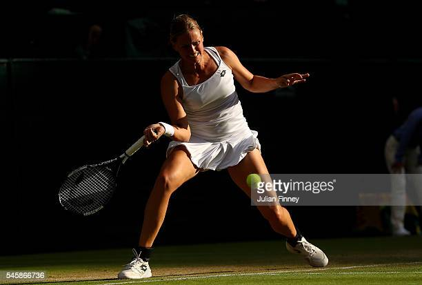 AnnaLena Groenefeld of Germany plays a forehand during the Mixed Doubles Final against Heather Watson of Great Britain and Henri Kontinen of Finland...