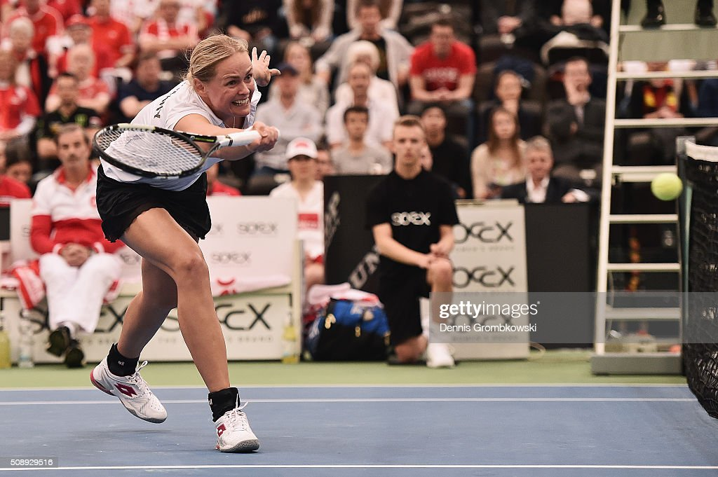 <a gi-track='captionPersonalityLinkClicked' href=/galleries/search?phrase=Anna-Lena+Groenefeld&family=editorial&specificpeople=193798 ng-click='$event.stopPropagation()'>Anna-Lena Groenefeld</a> of Germany plays a forehand in her double match with Andrea Petkovic on Day 2 of the 2016 FedCup World Group Round 1 match between Germany and Switzerland at Messe Leipzig on February 7, 2016 in Leipzig, Germany.
