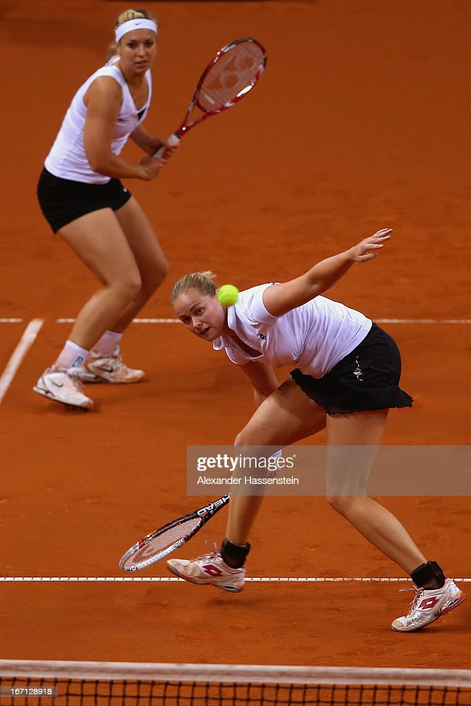 <a gi-track='captionPersonalityLinkClicked' href=/galleries/search?phrase=Anna-Lena+Groenefeld&family=editorial&specificpeople=193798 ng-click='$event.stopPropagation()'>Anna-Lena Groenefeld</a> (R) of Germany plays a forehand with her team mate <a gi-track='captionPersonalityLinkClicked' href=/galleries/search?phrase=Sabine+Lisicki&family=editorial&specificpeople=645395 ng-click='$event.stopPropagation()'>Sabine Lisicki</a> during her double match against Aleksandra Krunic and Vesna Dolonc of Serbia at the Fed Cup World Group Play off between Germany and Serbia at Porsche Arena on April 21, 2013 in Stuttgart, Germany.
