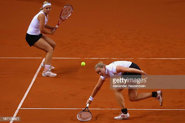 AnnaLena Groenefeld of Germany plays a forehand with her team mate Sabine Lisicki during her double match against Aleksandra Krunic and Vesna Dolonc...
