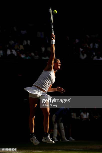 AnnaLena Groenefeld of Germany serves during the Mixed Doubles Final against Heather Watson of Great Britain and Henri Kontinen of Finland on day...