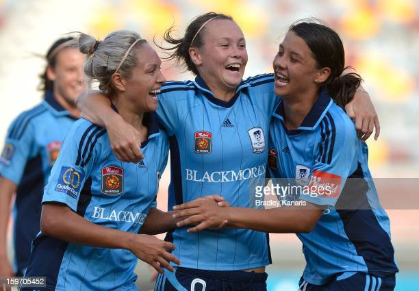 BRISBANE AUSTRALIA JANUARY Annalie Longo Caitlin Foord and Samantha Kerr celebrate victory after the WLeague Semi Final match between the Brisbane...