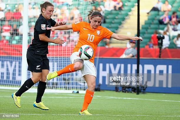 Annalie Longo of New Zealand defends Danielle Van De Donk of Netherlands during the FIFA Women's World Cup Canada 2015 Group A match between New...