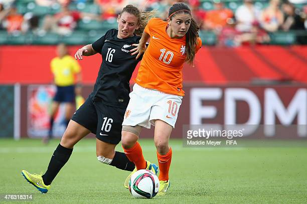 Annalie Longo of New Zedaland efends Danielle Van De Donk of Netherlands during the FIFA Women's World Cup Canada 2015 Group A match between New...