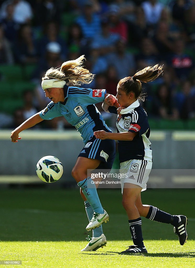 Annalie Longo of Sydney FC (L) controls the ball under pressure from Enza Barilla of the Victory during the W-League Grand Final between the Melbourne Victory and Sydney FC at AAMI Park on January 27, 2013 in Melbourne, Australia.