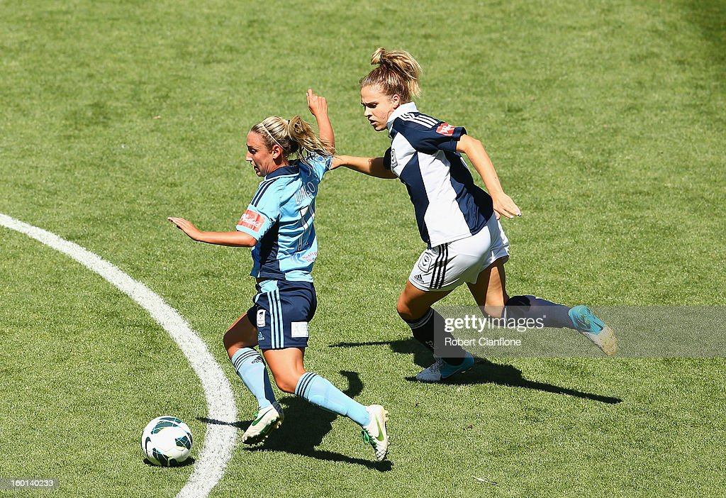 Annalie Longo of Sydney FC is chased by her opponent during the W-League Grand Final between the Melbourne Victory and Sydney FC at AAMI Park on January 27, 2013 in Melbourne, Australia.