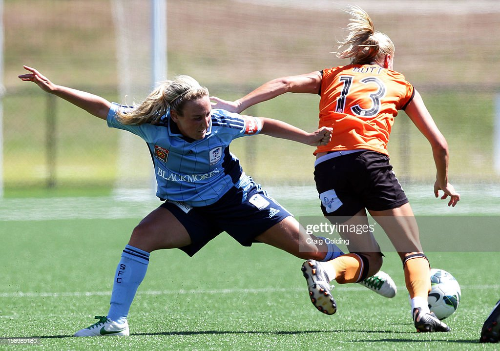 Annalie Longo of Sydney goes in for a tackle against Tameka Butt of the Roar during the round 11 W-League match between Sydney FC and the Brisbane Roar on January 5, 2013 in Sydney, Australia.