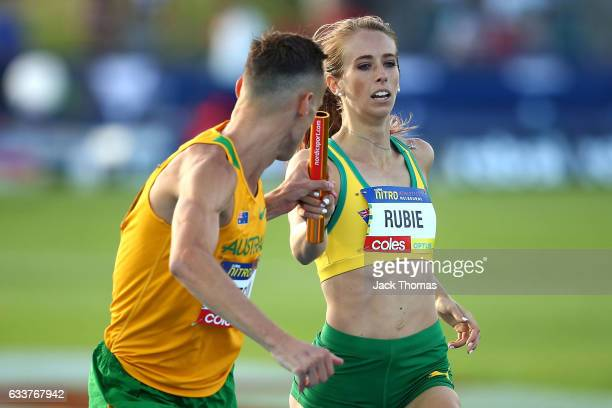 Annaliese Rubie of Australia passes the baton to Ryan Gregson of Australia in the Mixed Distance Medley during Nitro Athletics at Lakeside Stadium on...
