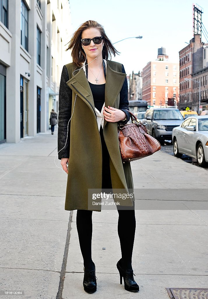 Annalisa Buehler, works in marketing from New York, seen outside the Perry Ellis by Duckie Brown show wearing a BCBG jacket and dress, Elizabeth and James shoes on February 12, 2013 in New York City.