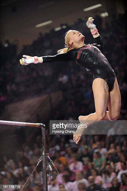 Annamari Maaranen of DU is in action on bars during 2011 NCAA gymnastics regional championship at Magness Arena of University of Denver on Saturday...