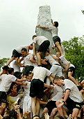 Annapolis Incoming Freshmen Climb Grease Covered Monument