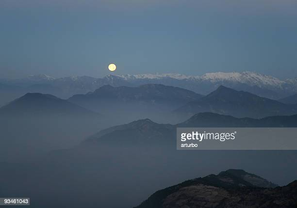 Annapurna mountain range and moon