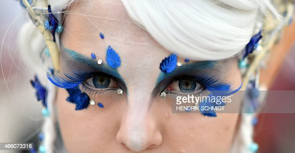 AnnCatrin wears a fancy makeup as she visits the Leipzig Book Fair on March 13 2015 in Leipzig eastern Germany Authors readers and publishers gather...