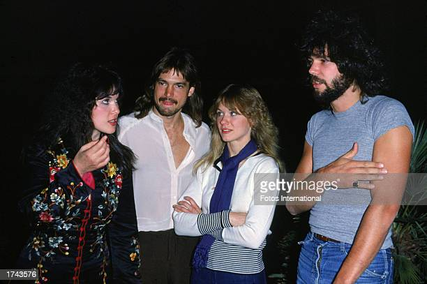 Anne and Nancy Wilson with two male members of their rock group Heart c 1977