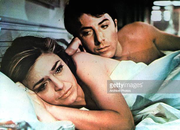 Anne Bancroft in bed with Dustin Hoffman in a scene from the film 'The Graduate' 1967