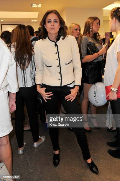 Anne Berest poses at Colette wearing Chanel during 'Vogue Fashion Night Out 2014' on September 16 2014 in Paris France