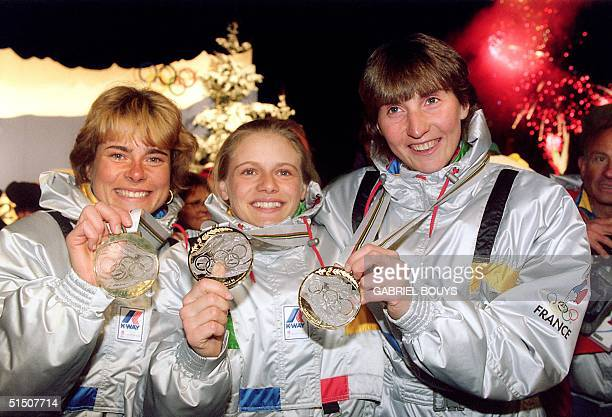 Anne Briand Veronique Claudel and Corinne Niogret from France smile on the podium as they display their gold medal won in the women's 3x75 km...