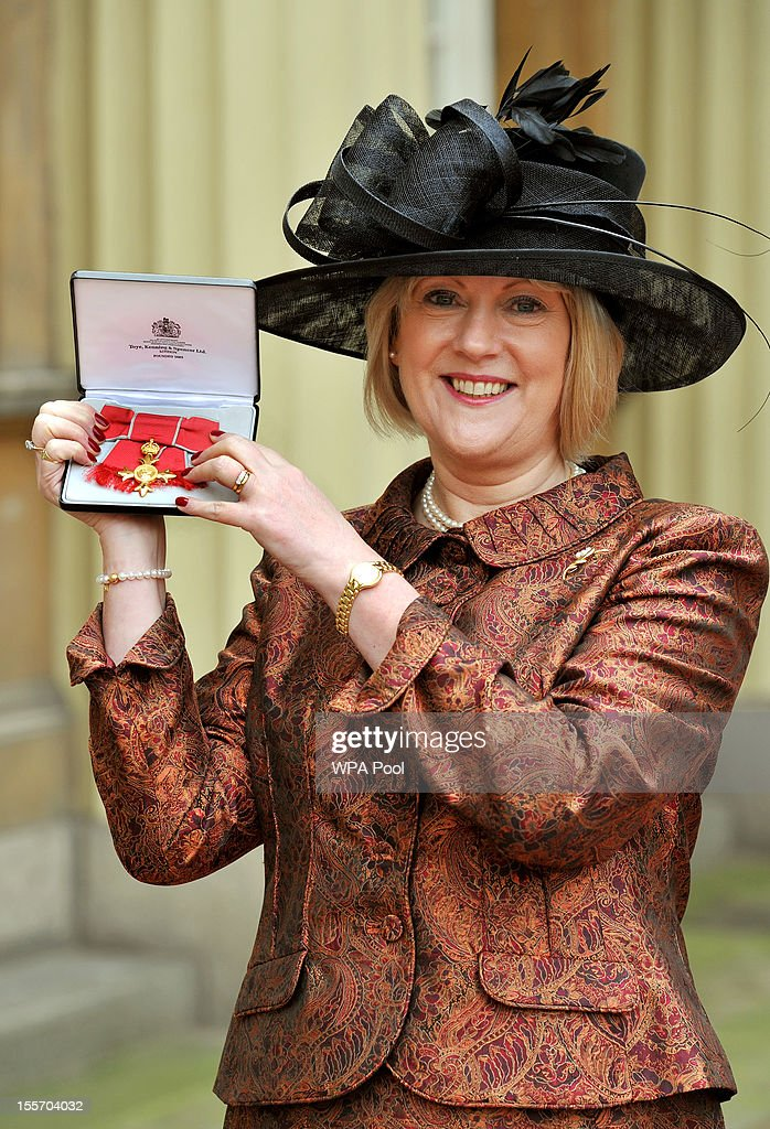 Anne Bulford holds her Officer of the British Empire (OBE) medal following an Investiture Ceremony hosted by the Princess Royal at Buckingham Palace on November 7, 2012 in London, England.