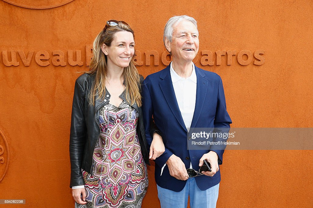 Anne Claire Coudray and Jean Claude Narcisse attend day four of the French Tennis Open at Roland Garros on May 25, 2016 in Paris, France.