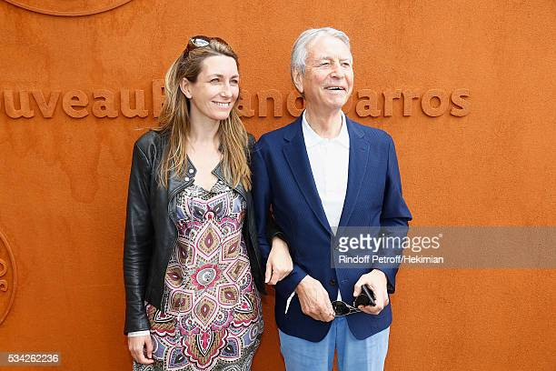 Anne Claire Coudray and Jean Claude Narcisse attend day four of the French Tennis Open at Roland Garros on May 25 2016 in Paris France