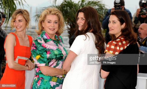Anne Consigny Catherine Deneuve Chiara Mastroianni and Emmanuelle Devos attend a photocall for 'Un Conte de Noel' during the 61st Cannes Film...