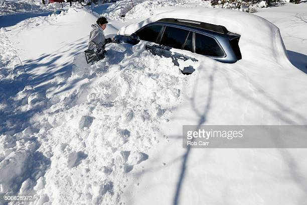 Anne DesMarais digs her car out of the snow on January 24 2016 in Baltimore Maryland Millions of people are digging themselves out after a record...
