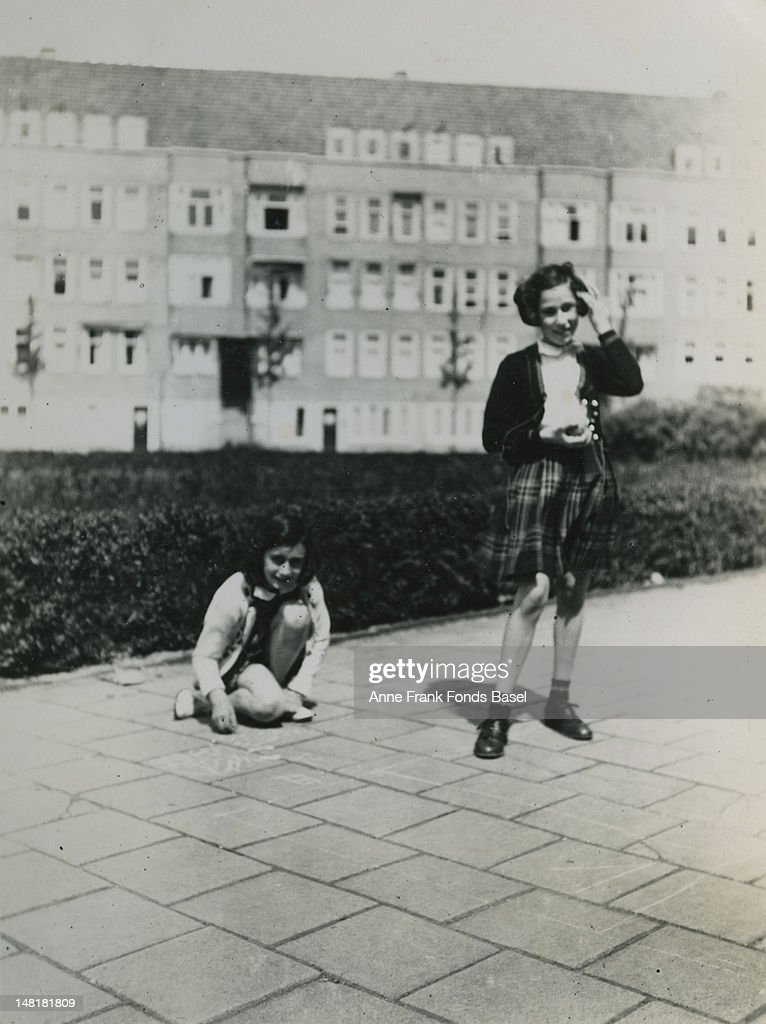 <a gi-track='captionPersonalityLinkClicked' href=/galleries/search?phrase=Anne+Frank&family=editorial&specificpeople=173492 ng-click='$event.stopPropagation()'>Anne Frank</a> (1929 - 1945) and her friend Hannah Goslar (known as Hanneli) playing at the Merwedeplein in Amsterdam, May 1940.