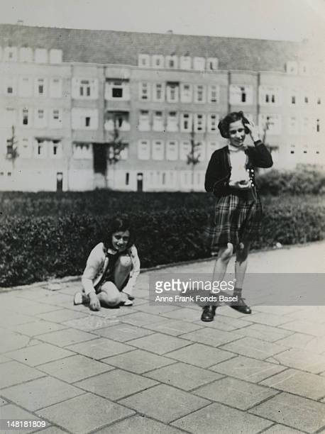 Anne Frank and her friend Hannah Goslar playing at the Merwedeplein in Amsterdam May 1940