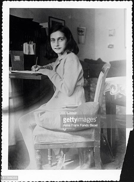Anne Frank writing at her desk in her house at Merwedeplein circa 1941