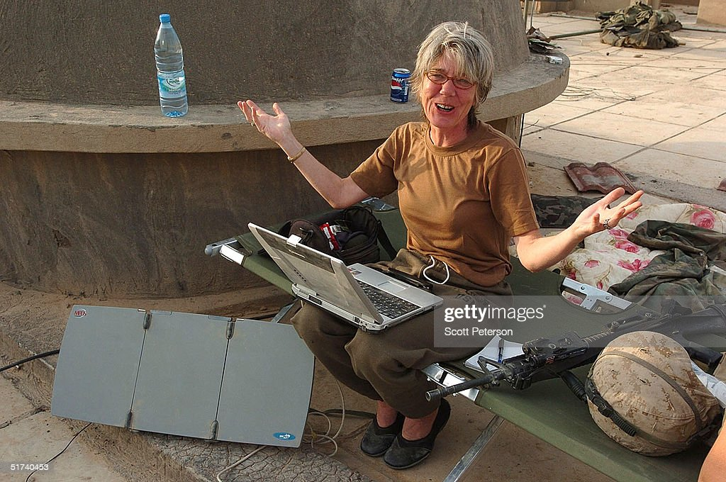 Anne Garrels, correspondent for National Public Radio, gestures as she works on a story on the roof of a U.S. Marine base November 14, 2004 in Fallujah, Iraq. U.S. and Iraqi forces continue to push their offensive in Fallujah, battling remaining pockets of resistance.