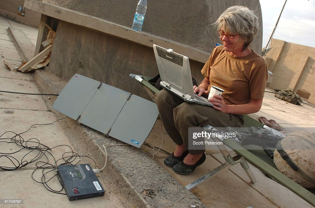 Anne Garrels, correspondent for National Public Radio, works on a story on the roof of a U.S. Marine base November 14, 2004 in Fallujah, Iraq. U.S. and Iraqi forces continue to push their offensive in Fallujah, battling remaining pockets of resistance.