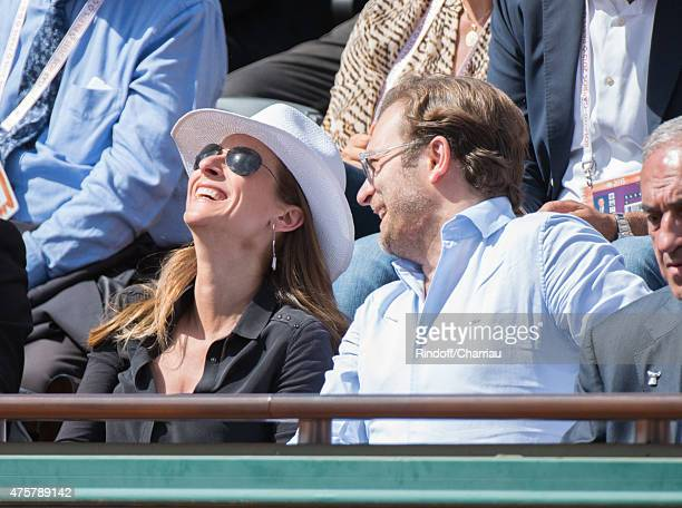 Anne Gravoin and Renaud Capuon attend the French open at Roland Garros on June 3 2015 in Paris France