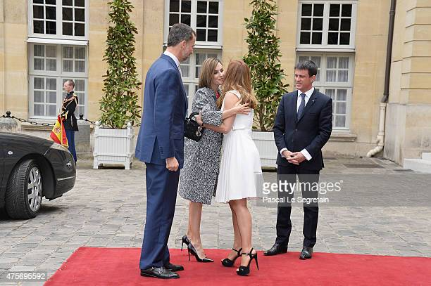 Anne Gravoin greets Queen Letizia of Spain as King Felipe of Spain and French Prime Minister Manuel Valls stand in the courtyard of the Hotel...