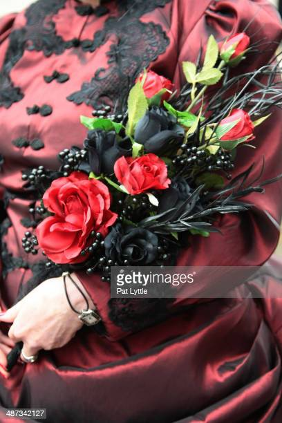 Anne Greenfield from Kings Lynn wears red bodice jacket with flower detail on April 26 2014 in Whitby England