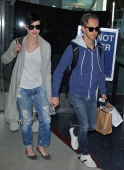Anne Hathaway and Adam Shulman are seen arriving at Los Angeles International airport on January 05 2014 in Los Angeles California