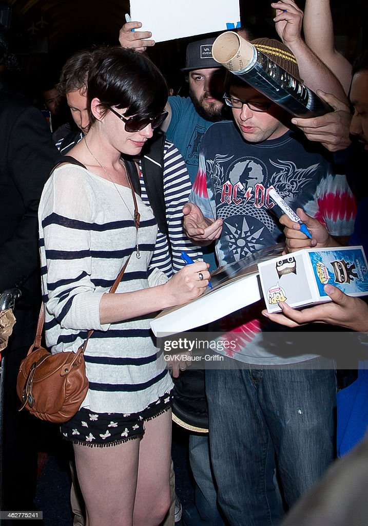 Anne Hathaway and Adam Shulman are seen at LAX airport on January 14 2014 in Los Angeles California