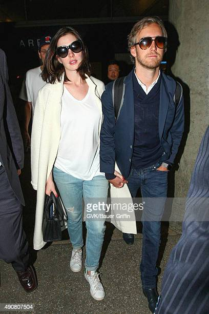 Anne Hathaway and Adam Shulman are seen at LAX on September 30 2015 in Los Angeles California