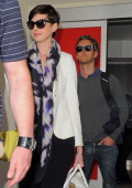 Anne Hathaway and Adam Shulman seen at LAX airport on March 10 2014 in Los Angeles California