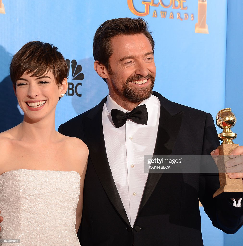 Anne Hathaway and Hugh Jackman pose with the best motion picture comedy or musical award for 'Les Miserables' in the press room at the Golden Globes awards ceremony in Beverly Hills on January 13, 2013. AFP PHOTO/Robyn BECK