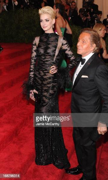 Anne Hathaway and Valentino attend the Costume Institute Gala for the 'PUNK Chaos to Couture' exhibition at the Metropolitan Museum of Art on May 6...