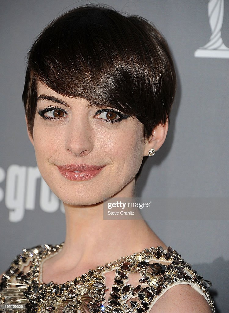 <a gi-track='captionPersonalityLinkClicked' href=/galleries/search?phrase=Anne+Hathaway+-+Attrice&family=editorial&specificpeople=11647173 ng-click='$event.stopPropagation()'>Anne Hathaway</a> arrive at the 15th Annual Costume Designers Guild Awards at The Beverly Hilton Hotel on February 19, 2013 in Beverly Hills, California.